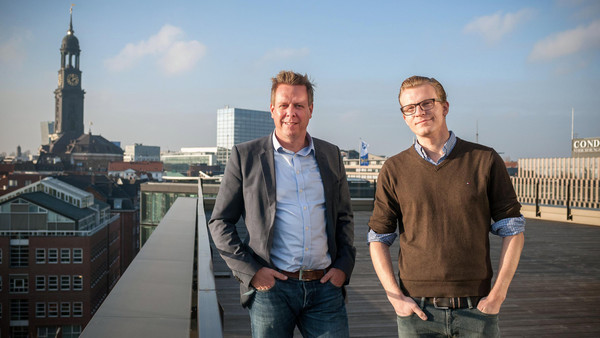 Kreditech CEO Alex Graubner Müller (AGM) and CFO Rene Griemens at the rooftop terrace of the fintech startup office in Hamburg Germany