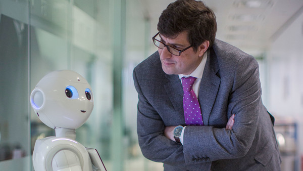 Robert Shrimsley and Pepper at the FT's London offices