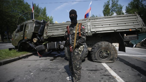 A Russian Orthodox Army member stands guard near Donetsk airport