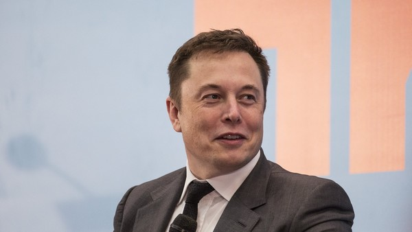 "Billionaire Elon Musk, chief executive officer of Tesla Motors Inc., speaks during the StartmeupHK Venture Forum in Hong Kong, China, on Tuesday, Jan. 26, 2016. Tesla is looking for a Chinese production partner but is ""still trying to figure that out,"" Musk said. Photographer: Justin Chin/Bloomberg"