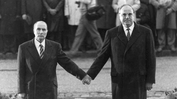 Late French President Francois Mitterrand and German Chancellor Helmut Kohl stand hand in hand
