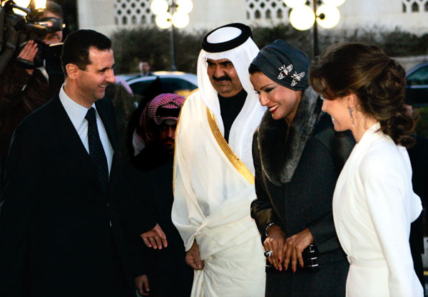 Qatar's Sheikh Hamad and his wife (centre) being greeted by Bashar and Asma al-Assad in Syria, 2008