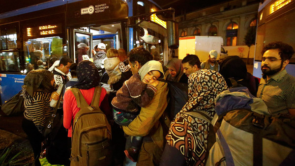 Migrants enter a bus, which is supposed to leave to Austria and Germany, at the Keleti trainstation in Budapest...Migrants enter a bus, which is supposed to leave to Austria and Germany, at the Keleti trainstation in Budapest, Hungary, September 4, 2015. REUTERS/Leonhard Foeger