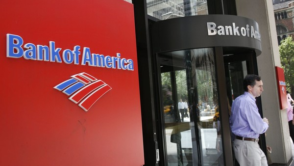 A customer leaves a branch of Bank of America in New York on Friday, July 28, 2006. Bank of America Corp., a Charlotte, North Carolina-based lender that makes almost 95 percent of its revenue in the U.S., is on the brink of overtaking Citigroup Inc. as the world's No. 1 bank by market value. Photographer: Tom Starkweather/Bloomberg News.