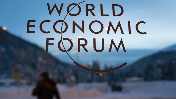 "The logo of the World Economic Forum (WEF) is seen on window pane at the Congress Center prior to the forum's annual meeting in Davos on January 18, 2016. More than 40 heads of states and governments will attend the WEF in Davos, which this year is focused on ""mastering the fourth Industrial Revolution,"" organisers said. / AFP / FABRICE COFFRINI (Photo credit should read FABRICE COFFRINI/AFP/Getty Images)"
