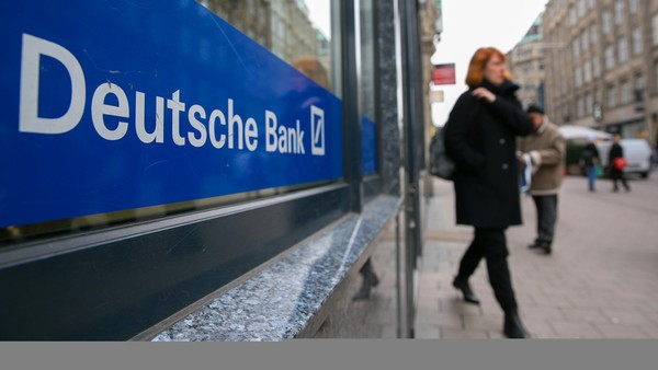 A woman leaves a Deutsche Bank AG branch in Hamburg, Germany, on Saturday, Feb. 13, 2016. Doubts about the coupon shattered confidence in Deutsche Bank cocos in February Photographer: Krisztian Bocsi/Bloomberg