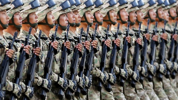 Soldiers of the People's Liberation Army (PLA) of China march in formation past the Tiananmen Square before a military parade to mark the 70th anniversary of the end of World War Two, in Beijing, China, September 3, 2015. REUTERS/Damir Sagolj - RTX1QTDS