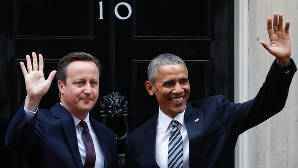 Britain's Prime Minister David Cameron (L) and US President Barack Obama (R) wave outside the door to 10 Downing Street ahead of talks in central London on April, 22, 2016. US President Barack Obama plunged into Britain's increasingly poisonous EU debate on Friday at the start of a visit, warning strongly against Brexit and pointing out that US soldiers had died for Europe. / AFP PHOTO / Adrian DENNISADRIAN DENNIS/AFP/Getty Images