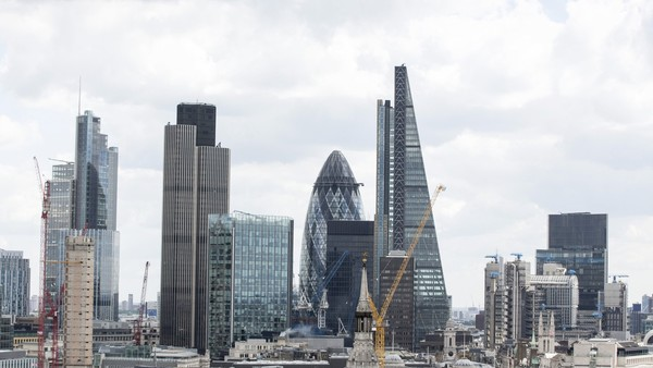 "A view of the City of London financial district including 30 St Mary Axe, also known as the ""Gherkin"", and the Leadenhall building, also known as the ""Cheesegrater"", are seen from St. Pauls Cathedral in London, U.K., on Monday, June 8, 2015. Job vacancies at London's financial services companies jumped 52 percent last month with banks seeking more fixed-income traders as volatility in markets increased, according to a recruitment firm. Photographer: Jason Alden/Bloomberg"