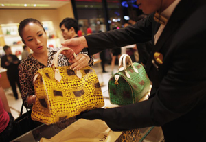 A woman shops in a Louis Vuitton store