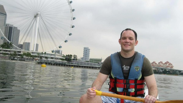 Shane Todd on a dragon boat in Singapore during an outing with friends and colleagues in 2011