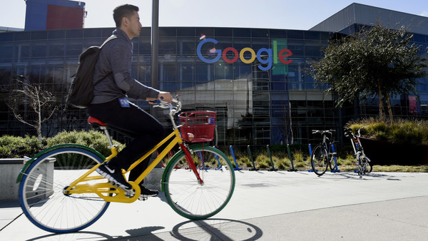 A cyclist rides past Google Inc. offices inside the Googleplex headquarters in Mountain View, California, U.S., on Thursday, Feb. 18, 2016. Google, part of Alphabet Inc., plans on tapping into existing fiber networks in San Francisco to deliver ultra-fast internet access across the city. Photographer: Michael Short/Bloomberg