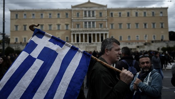 "Farmers demonstrate outside the Greek parliament during a protest against pension reform and tax issues, on February 12, 2016. Fears that Greece will exit the eurozone, a ""Grexit"", could revive if Greek authorities do not come up with ""credible"" reforms, notably on pensions, a senior IMF official said February 11. / AFP / ARIS MESSINIS (Photo credit should read ARIS MESSINIS/AFP/Getty Images)"