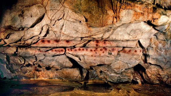 This pattern of red dots in northern Spain's El Castillo cave may have been painted as long as 36,000 years ago