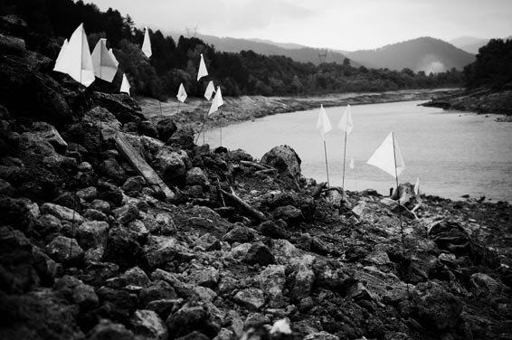 White flags mark the spots where skeletons were found in Visegrad