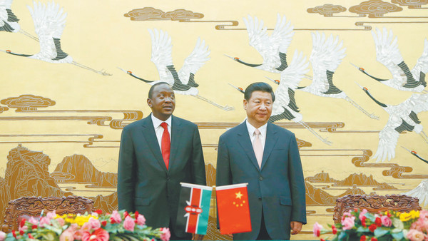 Kenya's President Uhuru Kenyatta (left) and his Chinese counterpart Xi Jinping attend a signing ceremony at the Great Hall of the People in Beijing on August 19, 2013