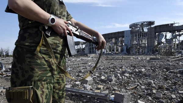 An armed pro-Russian militant stands guard in front the destroyed Lugansk International Airport, eastern Ukraine, on September 11, 2014. Pro-Russian separatists took control of the airport on September 1, 2014 after heavy fights with the Ukrainian army. Moscow has drawn up new anti-Western sanctions targeting imports of consumer goods and second-hand cars, President Vladimir Putin's economic aide said on September 11, as the EU agreed to slap new punitive measures on Russia. The new EU sanctions came as fighting in eastern Ukraine rumbles on despite a ceasefire agreed between Ukraine and separatists last week. AFP PHOTO / PHILIPPE DESMAZES (Photo credit should read PHILIPPE DESMAZES/AFP/Getty Images)