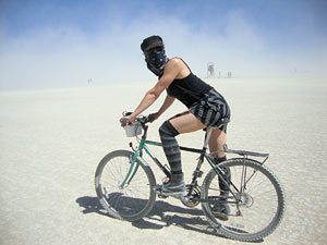 April Dembosky on a bike in the desert at the Burning Man festival in Nevada