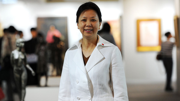 The photo taken on May 8, 2012 shows Wang Yannan, general manager of China Guardian auction house, posing for a picture in Beijing. Until recently, few in the art world had even heard of China's auction houses. Today, they are among the world's biggest by revenue, posing a serious challenge to the likes of Sotheby's and Christie's