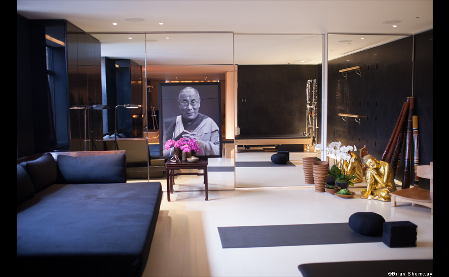 Donna Karan's yoga studio with a portrait of the Dalai Lama