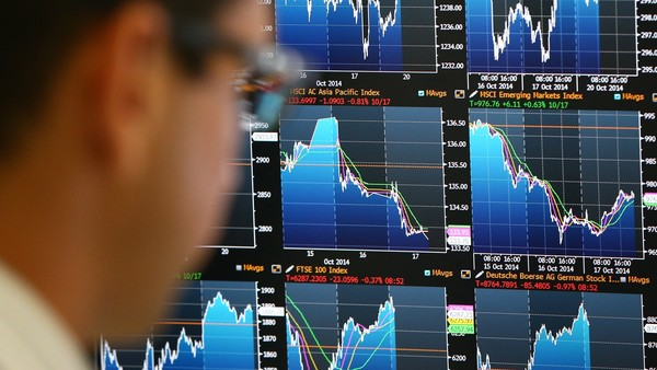 Smart beta essentially exploits consistent anomalies in how markets price particular kinds of stock - LONDON, ENGLAND - OCTOBER 20: An employee views trading screens at the offices of Panmure Gordon and Co in London, England. Markets stabilised over the weekend following global turbulence amid fears over the Ebola virus and global economic concerns. (Photo by Carl Court/Getty Images)
