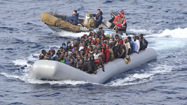 Migrants rescued by the Italian navy off the southern coast of Sicily