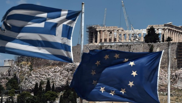 "An EU and a Greek flag wave in front of the ancient temple of Parthenon atop the Acropolis hill in Athens on July 7, 2015. Eurozone leaders will hold an emergency summit in Brussels on July 7 to discuss the fallout from Greek voters' defiant ""No"" to further austerity measures, with the country's Prime Minister Alexis Tsipras set to unveil new proposals for talks.. AFP PHOTO /ARIS MESSINISARIS MESSINIS/AFP/Getty Images"