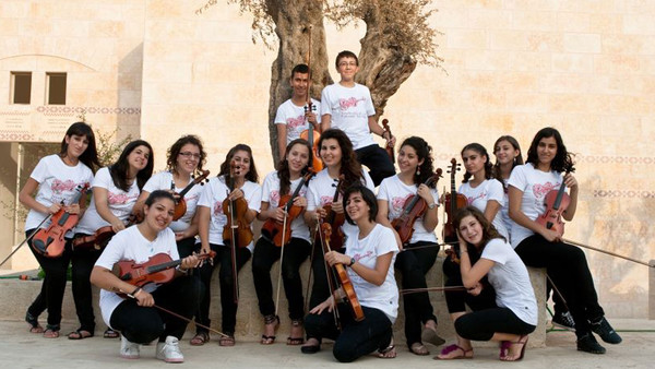 The Palestine Strings, whose players are aged between 12 and 22, at home before their visit to London this week