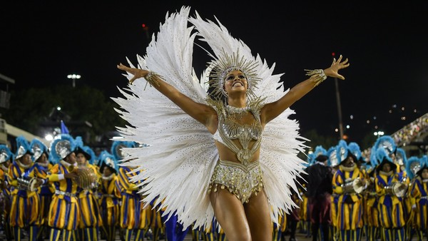 Revelers of the Unidos da Tijuca samba school perform during the second day of carnival parade in the Sambodrome in Rio de Janeiro, Brazil on February 17, 2015. AFP PHOTO/YASUYOSHI CHIBA (Photo credit should read YASUYOSHI CHIBA/AFP/Getty Images)
