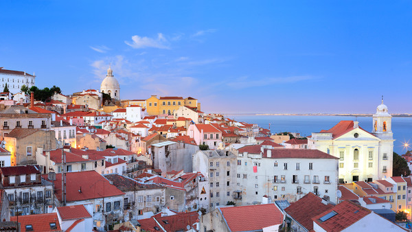 Lisbon's Alfama district, with the Church of São Vicente de Fora in the background