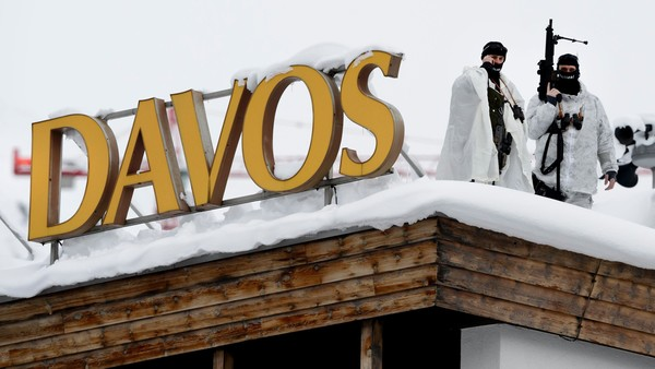 """Swiss special police forces take position next to a sign reading Davos at the opening of the World Economic Forum (WEF) annual meeting in Davos on January 19, 2016. More than 40 heads of states and governments will attend the WEF in Davos, which this year is focused on """"mastering the fourth Industrial Revolution,"""" organisers said. / AFP / FABRICE COFFRINI (Photo credit should read FABRICE COFFRINI/AFP/Getty Images)"""