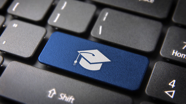 Education key with graduation hat icon on laptop keyboard