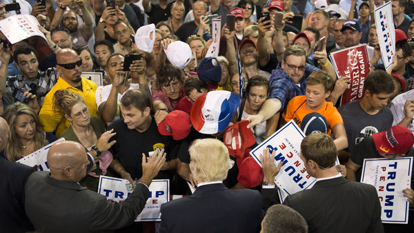Donald Trump, 2016 Republican presidential nominee, center, greets attendees during a campaign rally at the Erie Insurance Arena in Erie, Pennsylvania