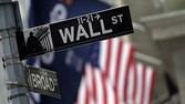 A Wall Street sign adjacent to the New York Stock Exchange, Thursday, Oct. 2, 2014. European stock markets opened with slight gains Thursday Dec. 11, 2014 after a nosedive in Asia as falling oil prices reinforced jitters about a sluggish global economy. (AP Photo/Richard Drew)