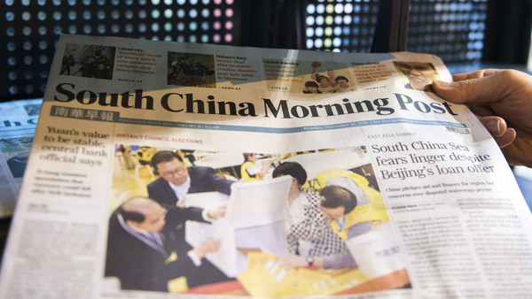 Copies of the South China Morning Post on a newspaper stand in Hong Kong