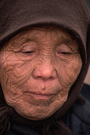 Close-up of the wrinkled face of a 99-year-old Evenki woman