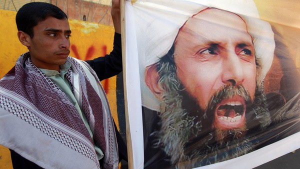 "(FILES) - A file picture taken in the Yemeni capital Sanaa on October 18, 2014, shows a protester taking part in a demonstration outside the Saudi embassy against the death sentence on Saudi Shiite cleric and anti-government protest leader, Nimr al-Nimr (portrait), after he was convicted by Saudi authorities of sedition. Saudi Arabia on January 2, 2016, executed 47 people convicted of ""terrorism"", including the prominent Shiite cleric, the interior ministry said. AFP PHOTO / MOHAMMED HUWAISMOHAMMED HUWAIS/AFP/Getty Images"
