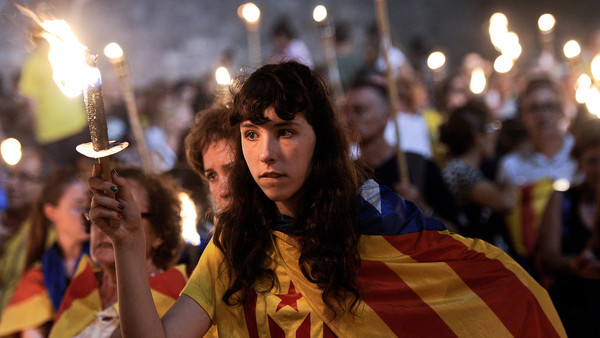 People hold torches during a rally as part of a campaign for independence from Spain, on the Fossar de les Moreres square in Barcelona on September 10, 2013, on the eve of the National Day of Catalonia, or Diada. Hundreds of thousands of Catalans are expected to unite on September 11 to create a 400-kilometre (250-mile) human chain as part of a campaign for independence from Spain which is fiercely opposed by Madrid. The chain will stretch across 86 cities, towns and villages along the coast of the northeastern region, passing landmarks such as the Sagrada Familia basilica in Barcelona and the city's Camp Nou football stadium