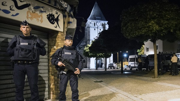 epa05442524 French riot police guards the street to access the church in Saint-Etienne-du-Rouvray where a fatal hostage taking incident happened, near Rouen, France, 26 July 2016. According to reports, two hostage takers were killed by the police after they took hostages at a church in Saint Etienne du Douvray. One of the hostages, a priest was killed by one of the perpetrators. EPA/IAN LANGSDON