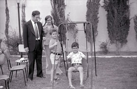 Bashar (on swing) in 1974 with his father Hafez, brother Majd and sister Bushra