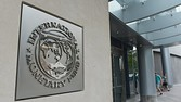 The seal of the International Monetary Fund is seen on a headquarters building in Washington, DC on July 5, 2015. The euro was dropping against the dollar after early results of the Greece bailout referendum suggested the country rejected fresh austerity demands from EU-IMF creditors. AFP PHOTO/MANDEL NGANMANDEL NGAN/AFP/Getty Images