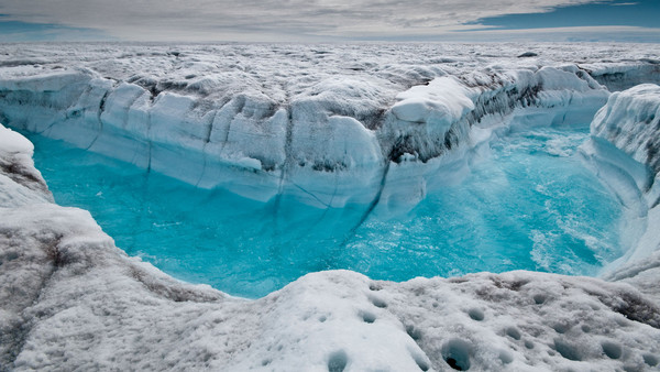 Meltwater rushes through a channel on the Greenland ice sheet