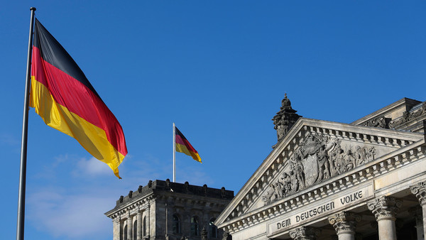 German national flags fly above the Reichstag building in Berlin, Germany, on Wednesday, July 16, 2014. Berlin's population has climbed 3 percent since 2005 to 3.4 million, about double that of second-placed Hamburg, and the government expects another 7 percent rise by 2030. Photographer: Chris Ratcliffe/Bloomberg