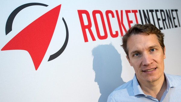 epa04414611 Founder and CEO of Rocket Internet AG Oliver Samwer stands in front of the company's logo at a press conference in Frankfurt, Germany, 24 September 2014. Rocket Internet plans to go public in October 2014. EPA/BORIS ROESSLER