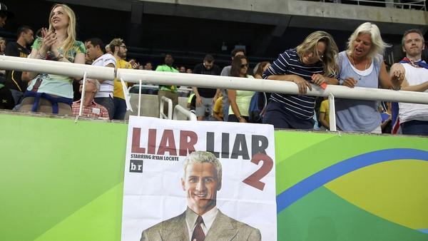 Enemy of the people: a poster accusing Ryan Lochte of lying hangs in Rio's Olympic stadium