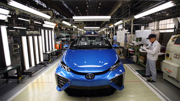 A Toyota worker checks a Mirai fuel-cell vehicle on the production line of the company's Motomachi plant
